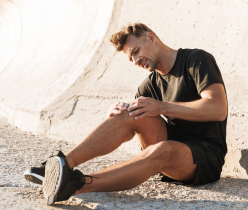 Portrait of an injured sportsman suffering from knee pain